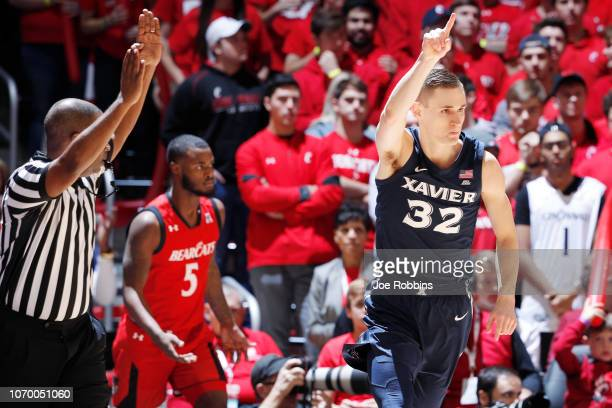 Ryan Welage of the Xavier Musketeers reacts after making a three-point shot against the Cincinnati Bearcats in the first half of the game at Fifth...