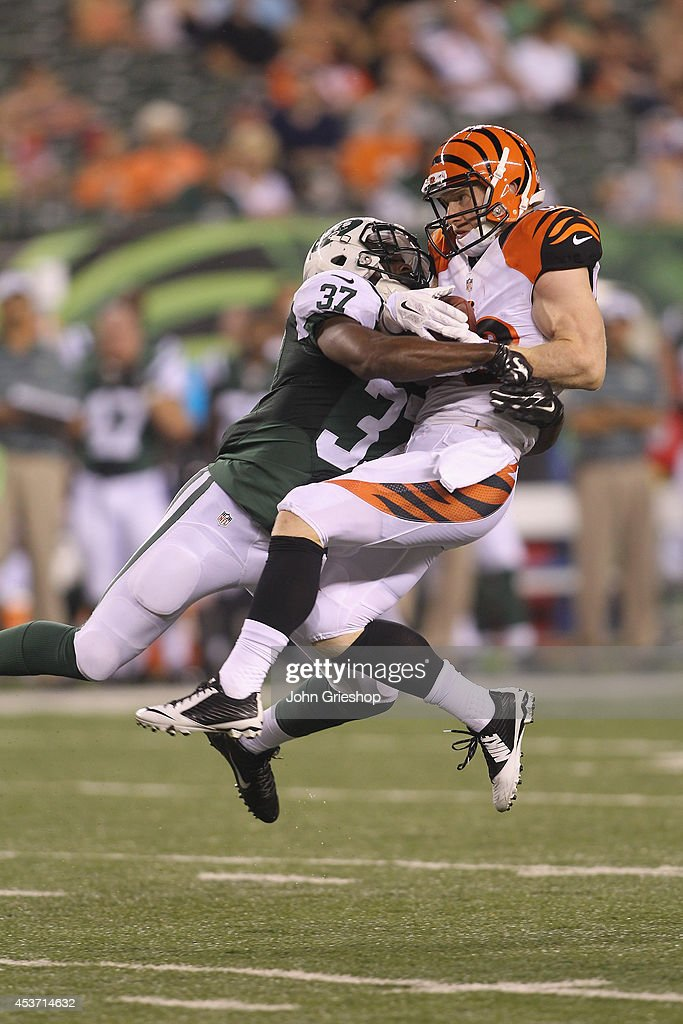 Ryan Whalen #88 of the Cincinnati Bengals hauls in a pass against Jaiquawn Jarrett #37 of the New York Jets at Paul Brown Stadium on August 16, 2014 in Cincinnati, Ohio. The Jets defeated the Bengals 25-17.