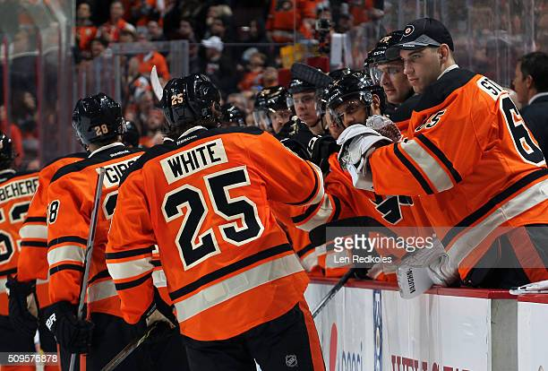 Ryan White and Anthony Stolarz of the Philadelphia Flyers celebrate White's second period power play goal with teammates against the New York Rangers...