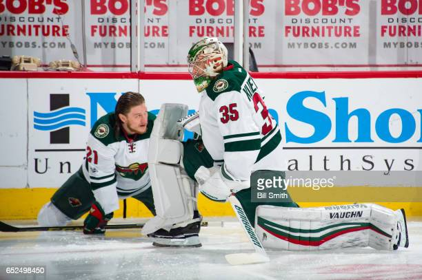 Ryan White and goalie Darcy Kuemper of the Minnesota Wild warm up prior to the game against the Chicago Blackhawks at the United Center on March 12...