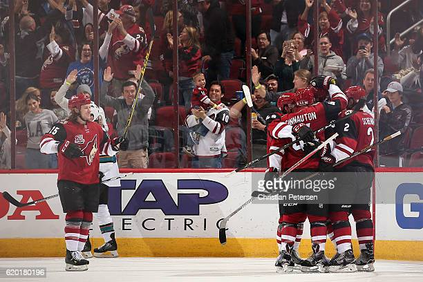 Ryan White Kevin Connauton Lawson Crouse and Luke Schenn of the Arizona Coyotes celebrate after Crouse scored a goal against San Jose Sharks during...