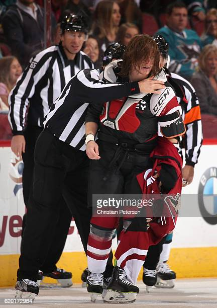 Ryan White of the Arizona Coyotes reacts after a fight with Micheal Haley of the San Jose Sharks during the first period of the NHL game at Gila...