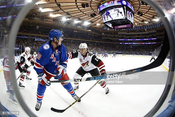 Ryan White of the Arizona Coyotes skates against JT Miller of the New York Rangers at Madison Square Garden on October 23 2016 in New York City
