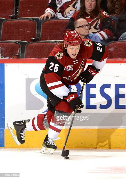 Ryan White of the Arizona Coyotes skates the puck up ice against the Colorado Avalanche at Gila River Arena on October 29 2016 in Glendale Arizona