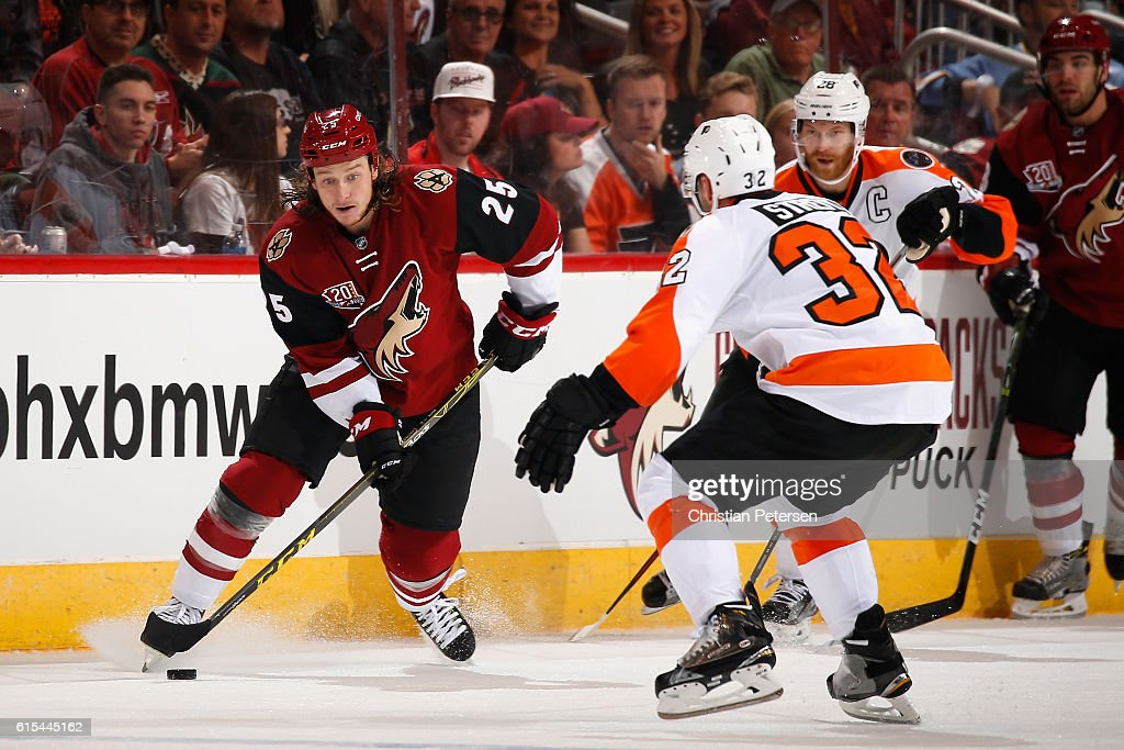 Ryan White #25 of the Arizona Coyotes skates with the puck against Mark Streit #32 of the Philadelphia Flyers during the NHL game at Gila River Arena on October 15, 2016 in Glendale, Arizona. The Coyotes defeated the Flyers 4-3 in overtime.