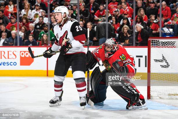 Ryan White of the Arizona Coyotes waits in position in front of goalie Corey Crawford of the Chicago Blackhawks in the second period at the United...