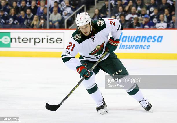 Ryan White of the Minnesota Wild follows the play down the ice during first period action against the Winnipeg Jets at the MTS Centre on February 28...