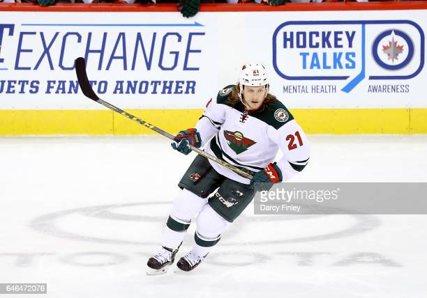 Ryan White of the Minnesota Wild keeps an eye on the play during second period action against the Winnipeg Jets at the MTS Centre on February 28 2017...