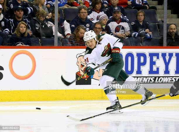 Ryan White of the Minnesota Wild shoots the puck towards the goal during third period action against the Winnipeg Jets at the MTS Centre on February...