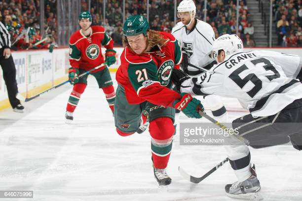 Ryan White of the Minnesota Wild shoots the puck with Kevin Gravel of the Los Angeles Kings defending during the game on February 27 2017 at the Xcel...