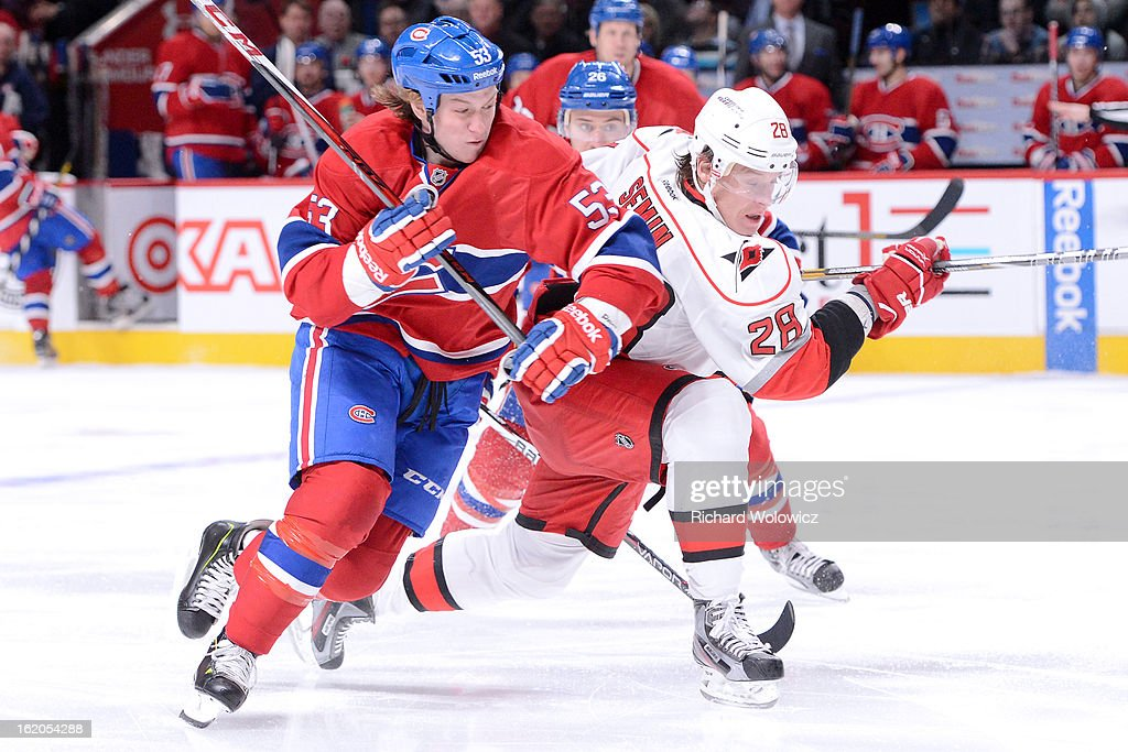 Ryan White #53 of the Montreal Canadiens and Alexander Semin #28 of the Carolina Hurricanes chase the puck during the NHL game at the Bell Centre on February 18, 2013 in Montreal, Quebec, Canada. The Canadiens defeated the Hurricanes 3-0.
