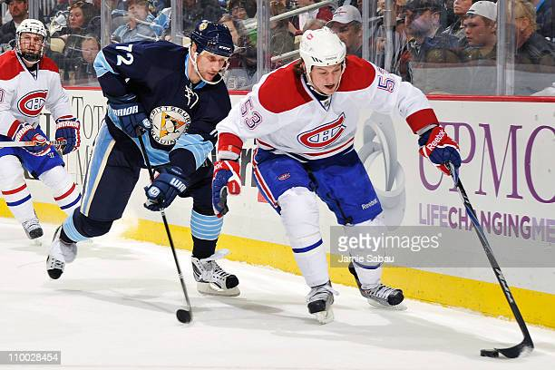 Ryan White of the Montreal Canadiens controls the puck as Alex Kovalev of the Pittsburgh Penguins defends on March 12 2011 at CONSOL Energy Center in...