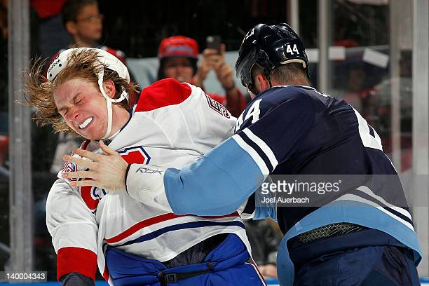 Ryan White of the Montreal Canadiens is hit by Erik Gudbranson of the Florida Panthers during a fight on February 26 2012 at the BankAtlantic Center...
