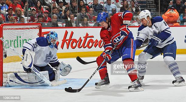 Ryan White of the Montreal Canadiens prepares to take a shot on goalie JeanSebastien Giguere of the Toronto Maple Leafs during the NHL game on...