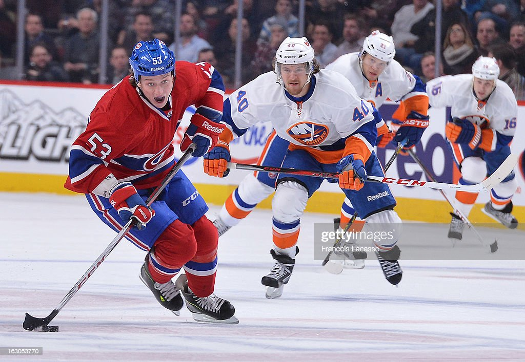 Ryan White #53 of the Montreal Canadiens skates with the puck against the New York Islanders during an NHL game on February 21, 2013 at the Bell Centre in Montreal, Quebec, Canada.