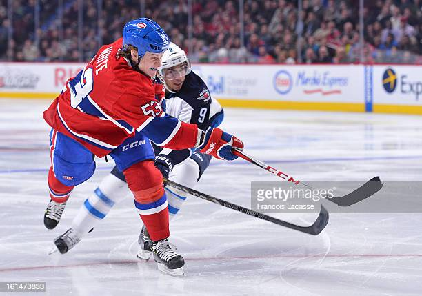 Ryan White of the Montreal Canadiens takes a shot in the third period against the Winnipeg Jets during the NHL game on January 29 2013 at the Bell...