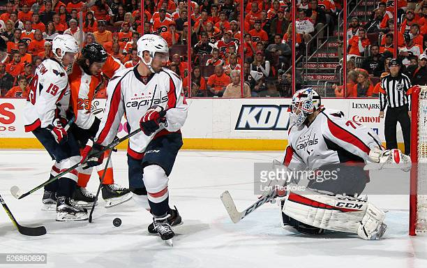 Ryan White of the Philadelphia Flyers attempts a shot on goal against Nicklas Backstrom Matt Niskanen and Braden Holtby of the Washington Capitals in...