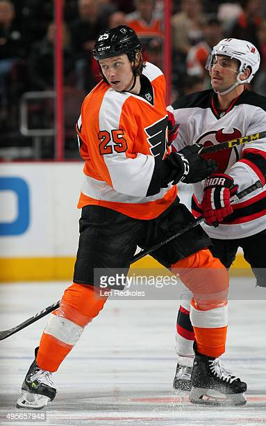 Ryan White of the Philadelphia Flyers battles Stephen Gionta of the New Jersey Devils following a faceoff on October 29 2015 at the Wells Fargo...