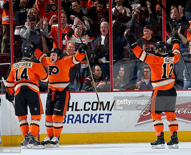 Ryan White of the Philadelphia Flyers celebrates his goal in the third period with teammates Sean Couturier and Michael Raffl in the third period...