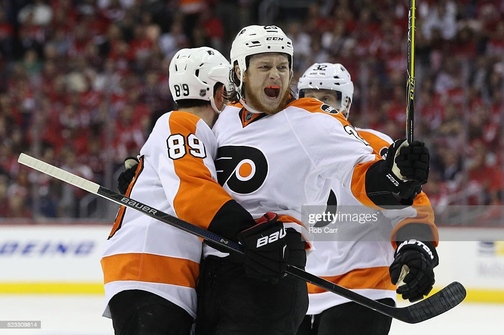 Ryan White #25 of the Philadelphia Flyers celebrates with Sam Gagner #89 after scoring a second period goal in Game Five of the Eastern Conference Quarterfinals during the 2016 NHL Stanley Cup Playoffs at Verizon Center on April 22, 2016 in Washington, DC.