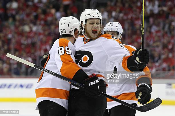 Ryan White of the Philadelphia Flyers celebrates with Sam Gagner after scoring a second period goal in Game Five of the Eastern Conference...