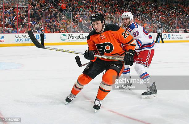 Ryan White of the Philadelphia Flyers skates against Keith Yandle of the New York Rangers on October 24 2015 at the Wells Fargo Center in...