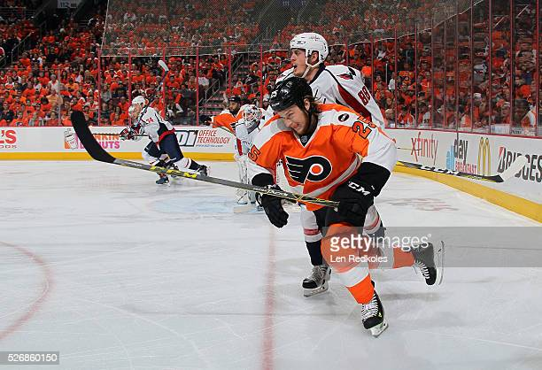 Ryan White of the Philadelphia Flyers skates against Nate Schmidt of the Washington Capitals in Game Six of the Eastern Conference First Round during...