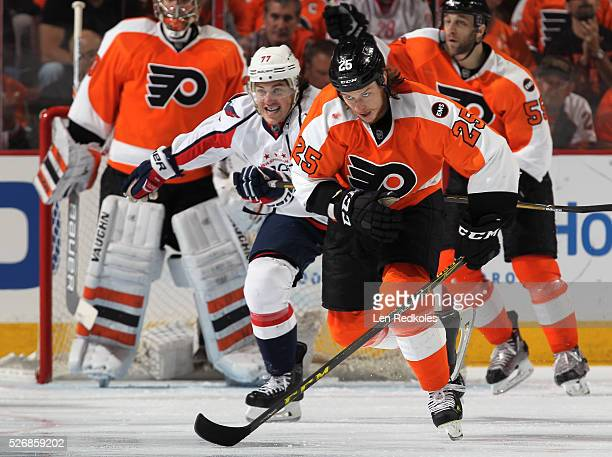 Ryan White of the Philadelphia Flyers skates against TJ Oshie of the Washington Capitals in Game Six of the Eastern Conference First Round during the...