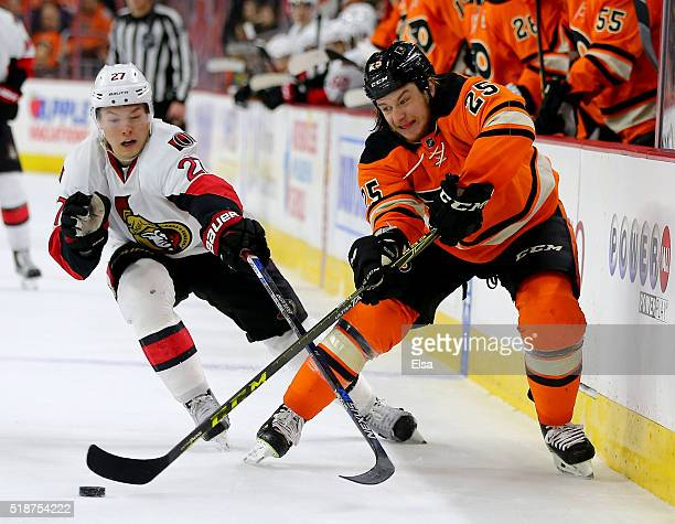 Ryan White of the Philadelphia Flyers tries to keep the puck away from Curtis Lazar of the Ottawa Senators at the Wells Fargo Center on April 2 2016...