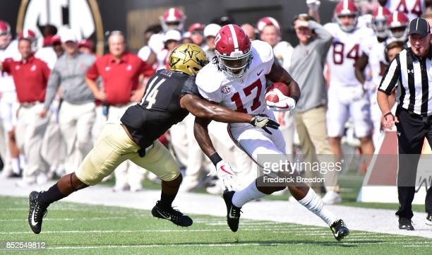 Ryan White of the Vanderbilt Commodores tackles Cam Sims of the Alabama Crimson Tide during the first half at Vanderbilt Stadium on September 23 2017...