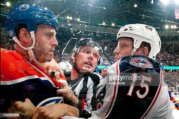 Ryan Whitney of the Edmonton Oilers argues with Derek Dorsett of the Columbus Blue Jackets during a game at Rexall Place on December 2 2011 in...