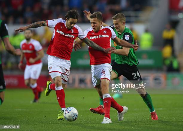 Ryan Williams and Will Vaulks of Rotherham United hold off a challenge from Ryan Yates of Scunthorpe United during the Sky Bet League One Play Off...