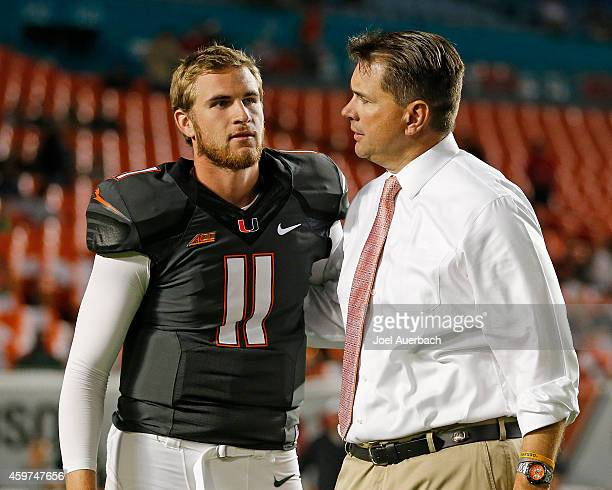 Ryan Williams is greeted by Head coach Al Golden of the Miami Hurricanes as part of the senior night ceremonies prior to the game against the...