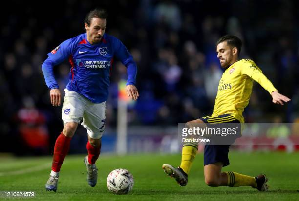 Ryan Williams of Portsmouth battles for the ball with Dani Ceballos of Arsenal during the FA Cup Fifth Round match between Portsmouth and Arsenal at...