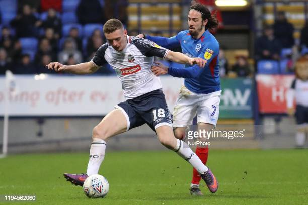 Ryan Williams of Portsmouth FC battles for possession with Ethan Hamilton of Bolton Wanderers during the Sky Bet League 1 match between Bolton...