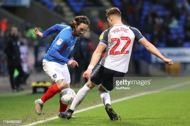 Ryan Williams of Portsmouth FC takes on Dennis Politic of Bolton Wanderers during the Sky Bet League 1 match between Bolton Wanderers and Portsmouth...