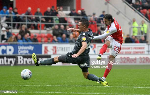 Ryan Williams of Rotherham United fires in a shot past Shaun Williams of Millwall during the Sky Bet Championship match between Rotherham United and...
