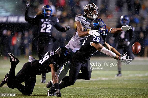 Ryan Williamson and Cameron Lewis of the Buffalo Bulls break up a pass intended for Carrington Thompson of the Western Michigan Broncos in the fourth...