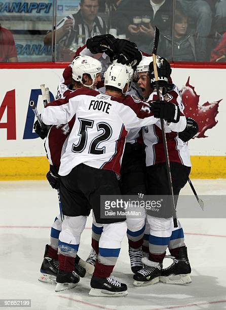Ryan Wilson Adame Foote and Paul Stastny of the Colorado Avalanche celebrate a play during a break in game action against the Calgary Flames on...