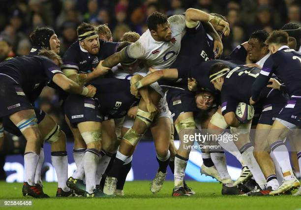 Ryan Wilson and John Barclay of Scotland in a scrum with Courtney Lawes of England of Scotland during the NatWest Six Nations Championship between...