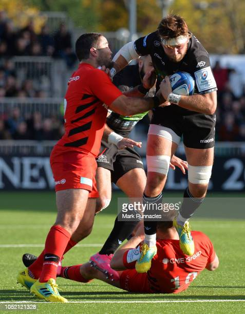 Ryan Wilson of Glasgow Warriors is tackled by Brad Barritt of Saracens during the Champions Cup match between Glasgow Warriors and Saracens at...