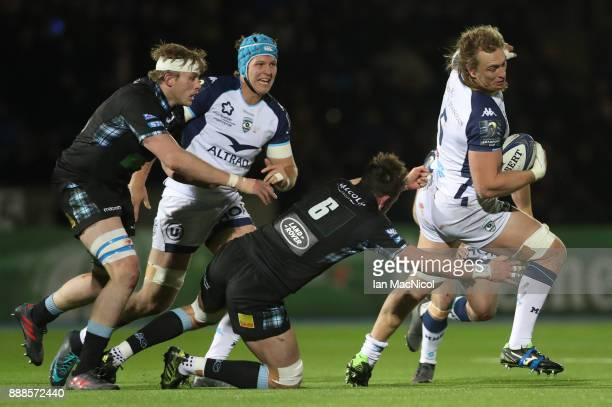 Ryan Wilson of Glasgow Warriors tackles Jacques Du Plessis of Montpellier during the European Rugby Champions Cup match between Glasgow Warriors and...