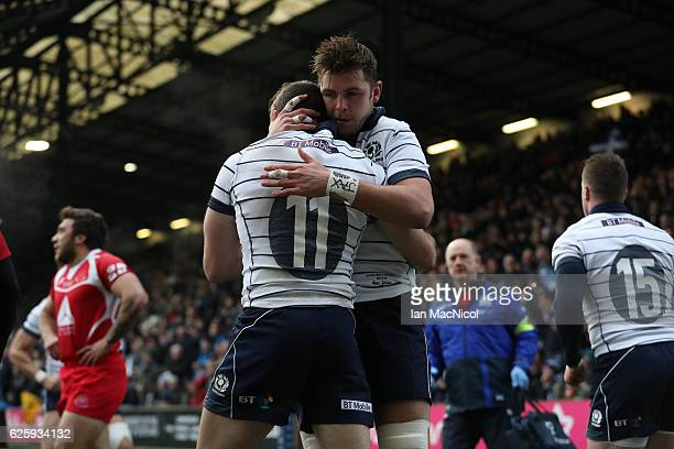 Ryan Wilson of Scotland congratulates Tommy Seymour of Scotland on his try during the Autumn Test Match between Scotland and Georgia at Rugby Park on...