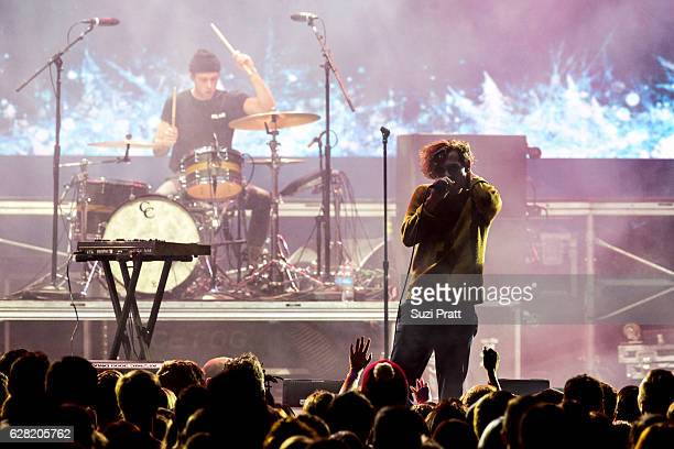 Ryan Winnen and Chase Lawrence of Coin perform at Deck the Hall Ball at KeyArena on December 6, 2016 in Seattle, Washington.