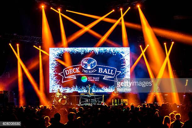 Ryan Winnen, Joe Memmel and Chase Lawrence of Coin perform at Deck the Hall Ball at KeyArena on December 6, 2016 in Seattle, Washington.
