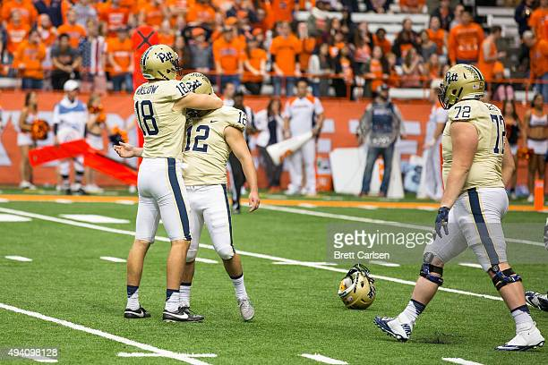 Ryan Winslow congratulates Chris Blewitt of the Pittsburgh Panthers for kicking the game winning field goal at the end of the fourth quarter against...