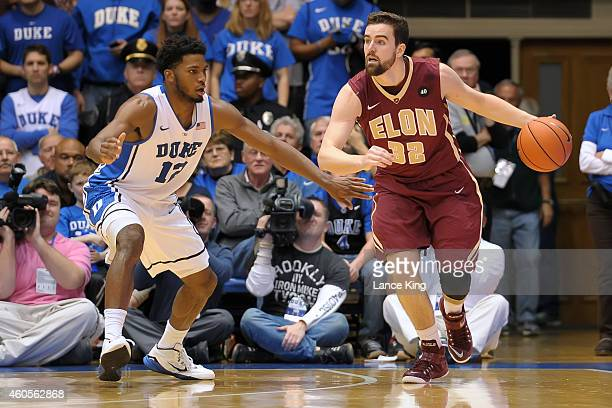 Ryan Winters of the Elon Phoenix moves the ball against Justise Winslow of the Duke Blue Devils during their game at Cameron Indoor Stadium on...