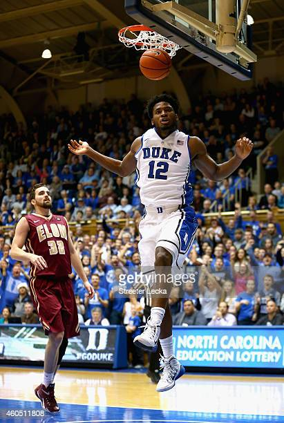 Ryan Winters of the Elon Phoenix watches as Justise Winslow of the Duke Blue Devils dunks the ball during their game at Cameron Indoor Stadium on...