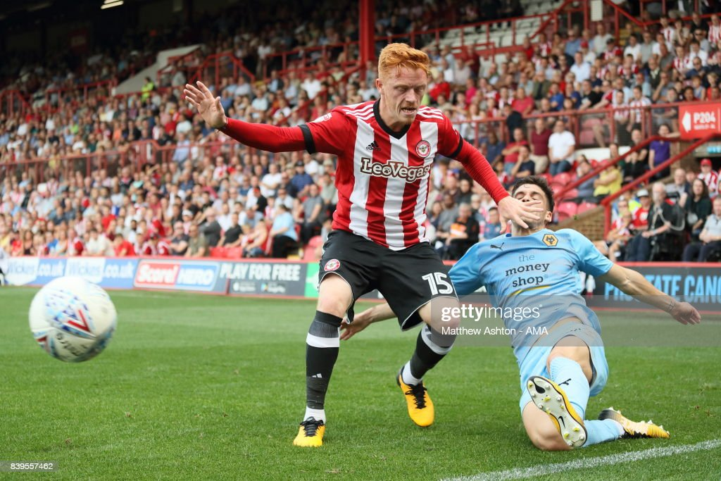 Ryan Woods of Brentford and Ruben Vinagre of Wolverhampton Wanderers during the Sky Bet Championship match between Brentford and Wolverhampton Wanderers at Griffin Park on August 26, 2017 in Brentford, England.
