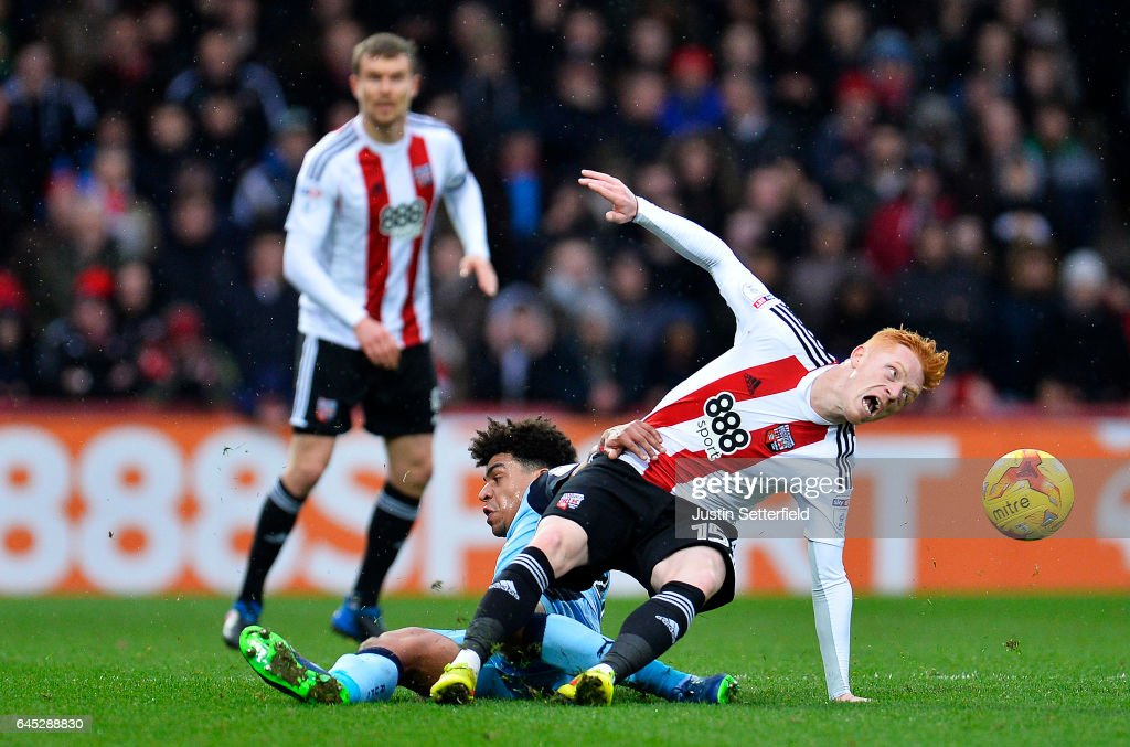 Ryan Woods of Brentford FC and Tom Adeyemi of Rotherham during the Sky Bet Championship match between Brentford and Rotherham at Griffin Park on February 25, 2017 in Brentford, England.